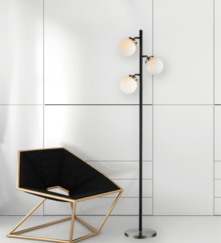 Floor Lamp Transitional Signature M & M 3592-89 near a modern chair with white wall