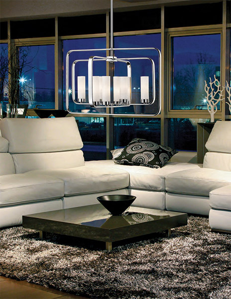 Luminaire suspendu transitionnel AIDEEN Z-Lite 6000-8A-CH allumé dans un salon avec divan en cuir blanc