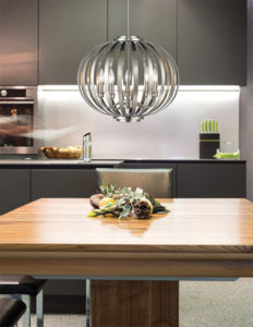 Pendant Lighting Transitional MOUNDOU Z-Lite 438-24BN over a wooden kitchen table