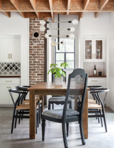 Wall Sconce Lighting Modern ASTRID Hudson Valley H178102-PN/BK in the kitchen with wall brick over a wooden table