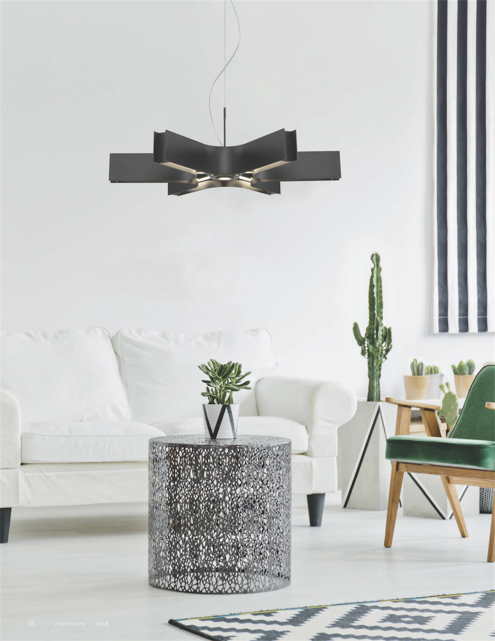 Pendant Lighting Transitional ARCANO Z-Lite 8002-24MB-LED in a living room above a leather white couch with table and cactus