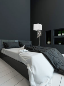 Wall Sconce Lighting / lecture Modern Dainolite DLED496-SC in a dark bedroom with black walls and white linens