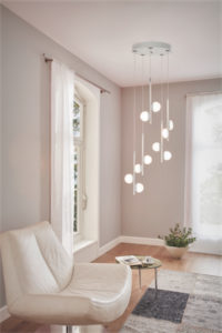 Pendant Lighting Modern OLINDRA Eglo 96932A in the living room near a white armchair