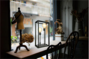 Table lamp Contemporary TAYLOR Signature M & M 4291-66 on a wooden table near the window with standing dummy