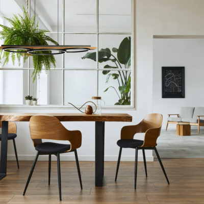 Modern pendant BOYAL Eglo 204922A above wooden dining table with wooden chairs