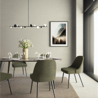 Modern pendant GEODE Kuzco LP50851-BK above the dining table with green velvet chairs